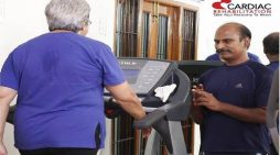 Dr Interacting with a patient during Rehab session